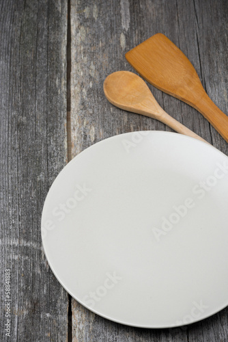 empty plate, wooden spatula and spoon, concept