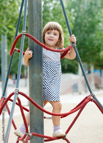 child on ropes at playground