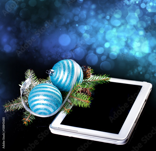 Tablet PC with Christmas decoration on black