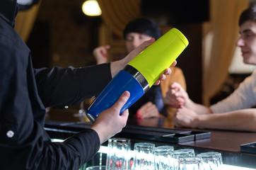 Barman mixing cocktails at a bar