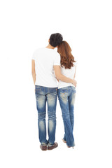 rear view of young couple looking and standing