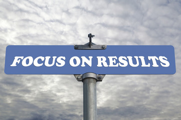 Focus on results road sign