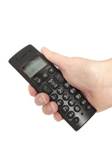 A hand holding a cordless telephone