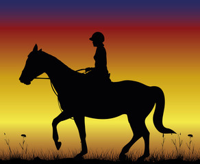 girl on horse - dressage on the backdround of sunset
