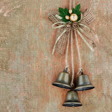 Vintage Christmas decoration hanging over wooden background
