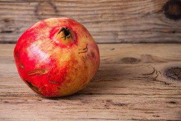 Pomegranate on the old wood background