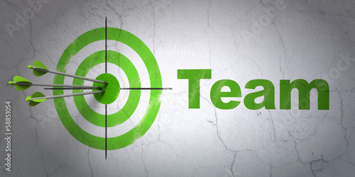 Business concept: target and Team on wall background