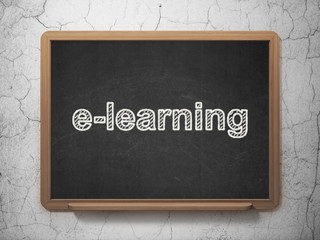Education concept: E-learning on chalkboard background