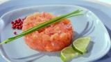 salmon tartare with chives, pepper and lime