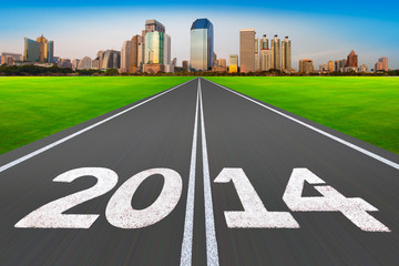 """New Year 2014 concept"", road with modern city."