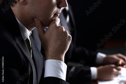 business team in meeting on dark background