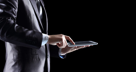 Man holding and touching digital tablet