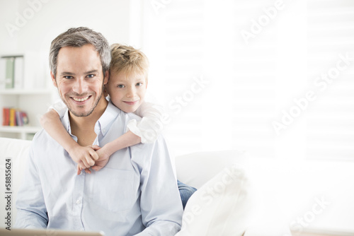 Father and his young son smiling