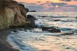 Stunning landscape dawn sunrise with rocky coastline