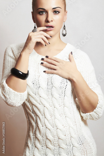 Beautiful woman in woolen dress.accessories.flirt.fashion