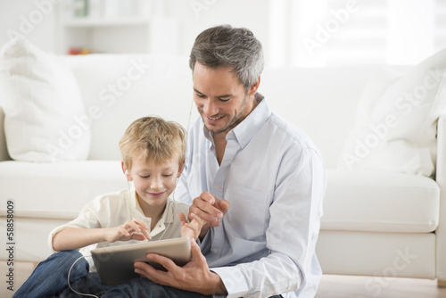 father and son sharing music headphones