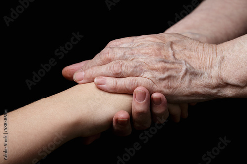 granddaughter and grandmother holding hands