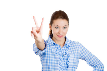 Excited young business woman giving victory sign