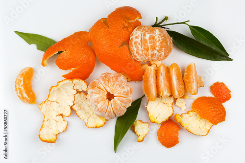 Delicious mandarins and peel with sprigs
