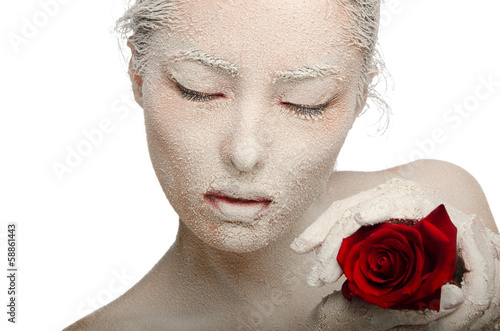 Woman in the snow with a red rose