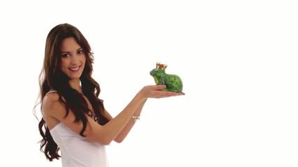 woman kisses a frog