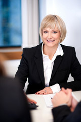 Businesswoman working with her colleagues
