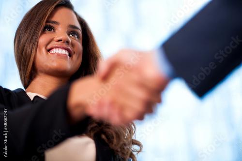 Poster A handshake between business people