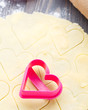 Heart shaped cookie cutter on raw dough