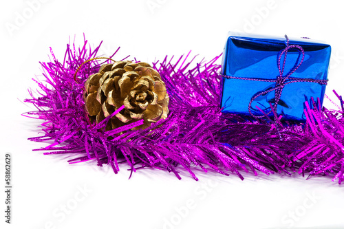 pinecone and gift box on tinsel