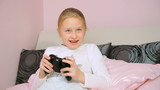 Girl playing video game having fun and win