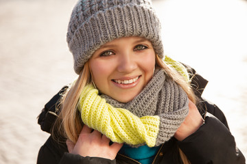 Pretty young woman in winter clothes