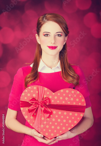 Redhead girl with shape heart box.