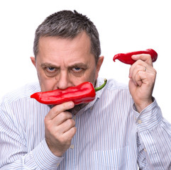 A man with a red pepper