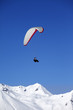 Paraglider in snowy winter mountains