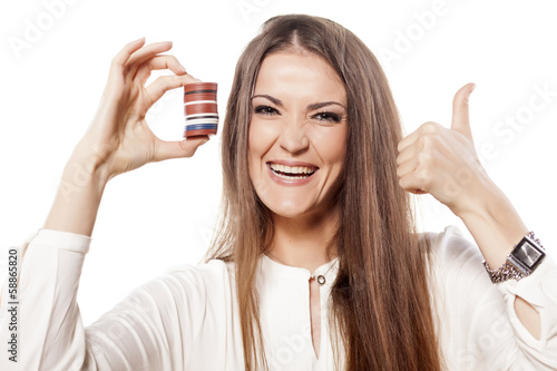 woman holding a pile of chips in her hands and showing thumbs up