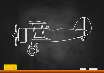 Drawing of aircraft on blackboard