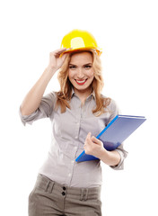 Cheerful woman engineer wearing protection helmet and holding a