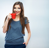 Coffee cup. Young woman on isolated studio background drink co