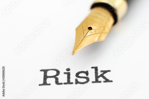 Fountain pen on risk text