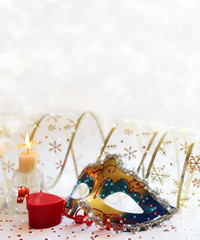 Christmas background with a mask, gifts and candles