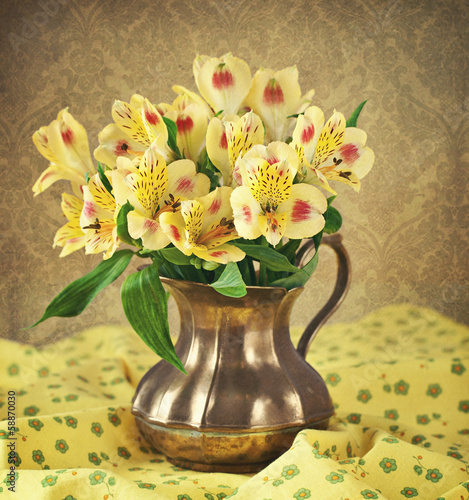 beautiful yellow flowers in a vintage jug (retro style)