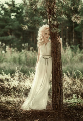 Portrait of romantic woman in forest