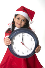 Little girl on Santa Claus costume holding Watch