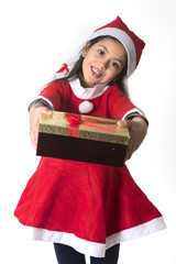 Cute Little Girl in Santa Claus costume holding a Christmas Box