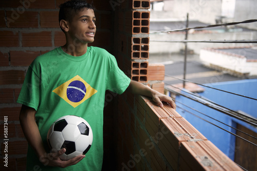 Smiling Brazilian Soccer Player Looks Out Favela Window