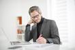 man writing at office