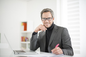 attractive man working in office