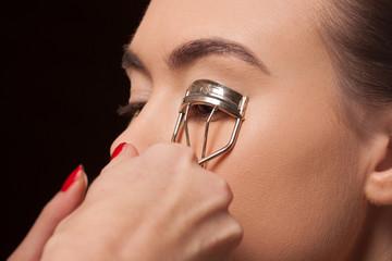 Young model having false eyelashes applied