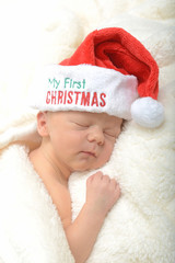 newborn infant and first Christmas