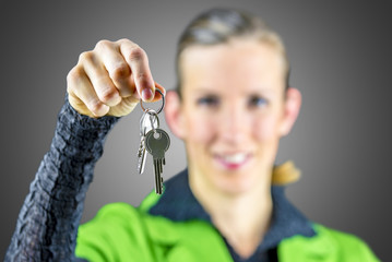 Young woman offering you house keys